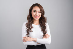 Smiling confident businesswoman isolated on grey background. Smiling confident businesswoman isolated on grey background Royalty Free Stock Photo