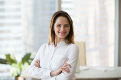 Smiling confident businesswoman looking at camera in office, hea stock images