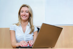 Smiling confident businesswoman. Strong business woman at her desk Royalty Free Stock Photography