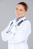 Smiling confident female doctor Stock Images