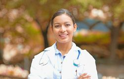 Smiling confident female doctor healthcare professional Royalty Free Stock Photos