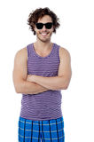 Smiling confident guy in beach wear Stock Photos