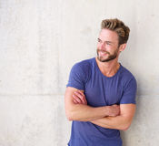 Smiling confident guy with beard posing with arms crossed Stock Photo