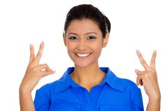 Smiling confident happy woman giving peace victory or two sign gesture. Closeup portrait of young happy smiling confident excited woman giving peace victory or Stock Image