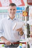 Man doing grocery shopping royalty free stock image