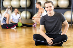Smiling and confident man at the fitness gym Royalty Free Stock Image