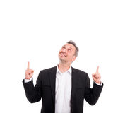 Smiling confident man pointing fingers up Stock Images