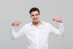 Smiling confident man pointing on himself Stock Photos