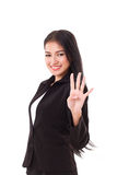 Smiling, confident, successful business woman executive showing 4 fingers hand gesture Royalty Free Stock Photos