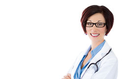 Smiling confident woman doctor, wearing glasses, hands crossed Royalty Free Stock Photography