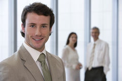 Smiling and confident young bu Stock Photo