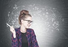 Cheerful young hipster woman, arrows royalty free stock photography