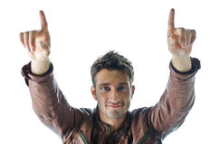 Smiling and confident young man pointing fingers up Royalty Free Stock Photos