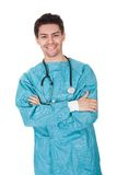 Smiling confident young surgeon Stock Photography