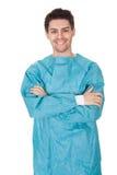 Smiling confident young surgeon Stock Photos