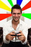 Smiling Console Gamer. Smiling Gamer sitting on couch with controller and playing Royalty Free Stock Photos
