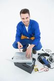 Smiling construciton worker pointing at laptop Stock Photography