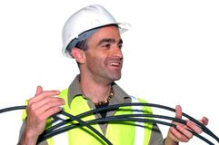 Smiling construction worker. With a cable Stock Image