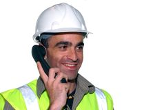 Smiling construction worker. With a phone Stock Images
