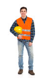 Smiling construction worker with helmet under the arm. Royalty Free Stock Photos