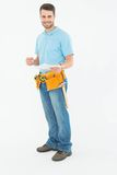 Smiling construction worker holding clipbard Stock Image