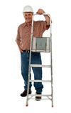 Smiling construction worker holding ladder Royalty Free Stock Images