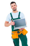Smiling construction worker holding laptop Stock Photography