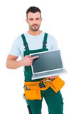 Smiling construction worker holding laptop Stock Images