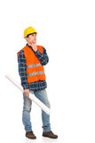 Smiling construction worker holding rolled paper plan. Royalty Free Stock Photos