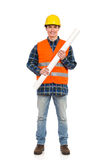Smiling construction worker holding rolled paper plan. Royalty Free Stock Image
