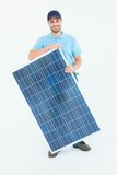 Smiling construction worker holding solar panel Royalty Free Stock Photo