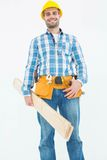 Smiling construction worker holding wooden planks Royalty Free Stock Image
