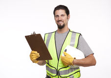 Smiling construction worker posing with a hardhat and clipboard Stock Images
