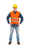 Smiling construction worker posing. Royalty Free Stock Image