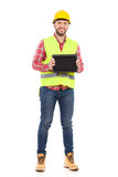 Smiling construction worker showing a shockproof digital tablet Stock Image