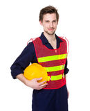 Smiling construction worker in yellow helmet and lime waistcoat Royalty Free Stock Images