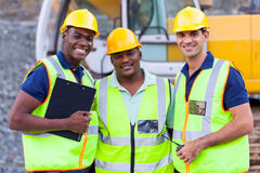 Smiling construction workers. Portrait of smiling construction workers royalty free stock photos
