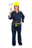 Smiling constrution worker displaying hammer Royalty Free Stock Photo