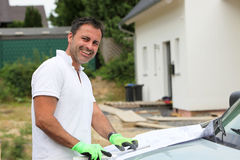 Smiling contractor at building site Royalty Free Stock Photography