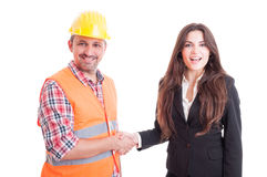 Smiling contractor and business woman shaking hands Royalty Free Stock Photography