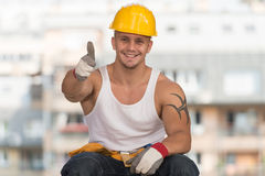 Smiling Contractor Showing Thumb Up Stock Photo