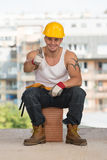 Smiling Contractor Showing Thumb Up Royalty Free Stock Photos