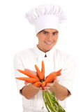 Smiling cook with bunch of carrots Royalty Free Stock Photography