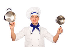 Smiling cook chef with kitchenware Stock Photography