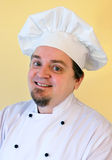 Smiling cook chef on yellow Stock Photos