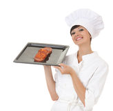 Smiling cook girl showing raw meat Royalty Free Stock Photo