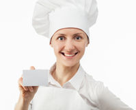 Smiling cook holding an empty visiting Stock Photo