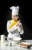 Smiling cook in kitchen Royalty Free Stock Photos