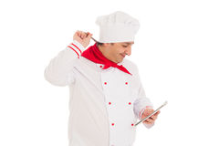 Smiling cook man holding notebook and pen, thinking Stock Images