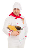 Smiling cook man holding pan filled with raw macaroni wearing wh Royalty Free Stock Photos